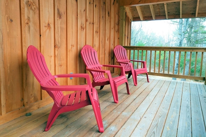 Two Second Floor Balconies And Adirondack Chairs