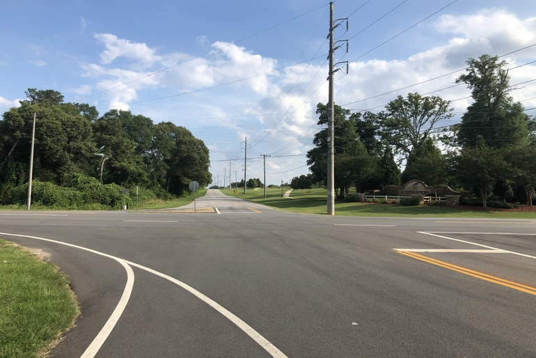 The Property Features Excellent Access With Road Frontage At The Intersection Of Hwy 341 And Airport Road With Houston Springs Residential Development.