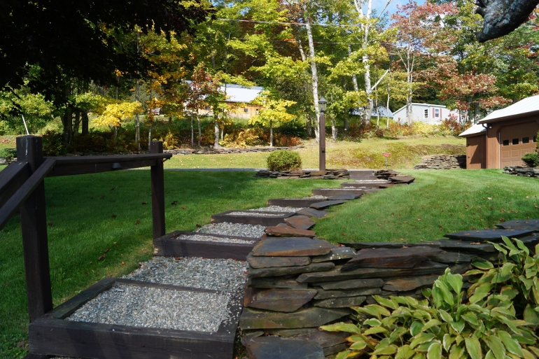 Stone Walls, Gardens And Steps Enhance The Grounds
