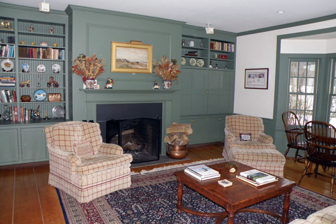 Great Room With Feature Open Fireplace, Built-Ins And Hidden Tv Storage