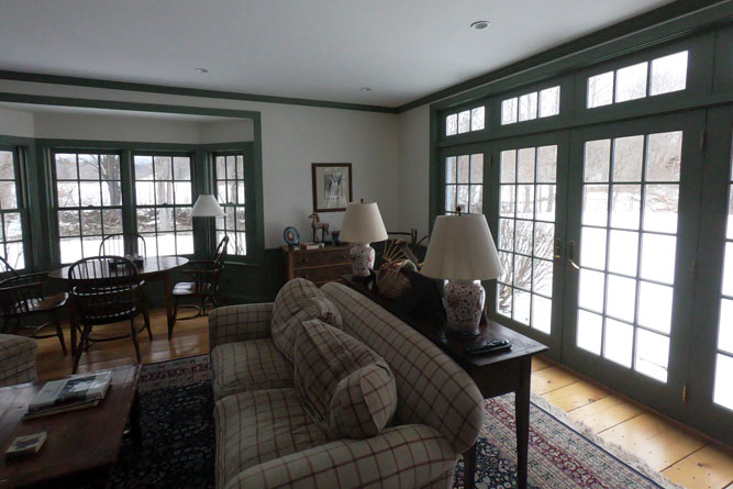 Great Room Showing The Many Windows And French Doors Leading To The Back Yard