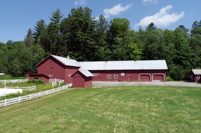 Large, L-Shaped, Two-Story, 16,000 Sq Ft Barn With Paddocks