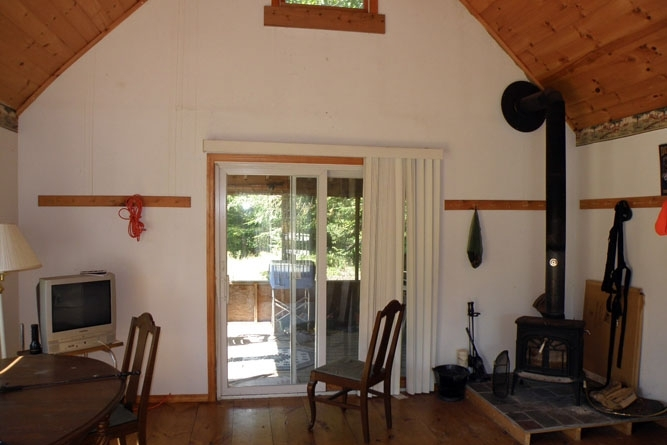 Camp Interior Facing Toward The Screened Porch And Pond