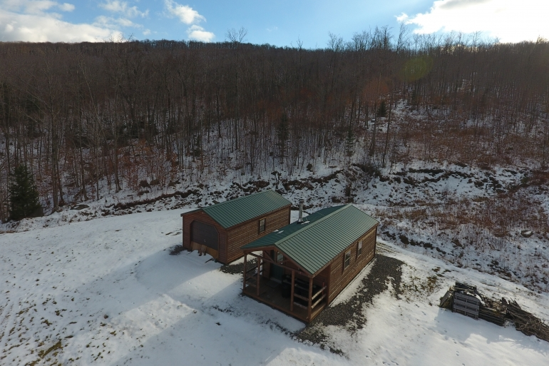 A Simple Off-Grid Cabin In The Center Of The Property